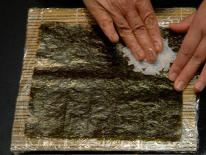Take some rice and start placing it on the nori