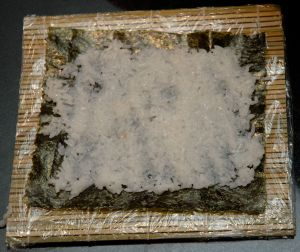 Cover the entire nori with rice evenly. Leave space around the edges.